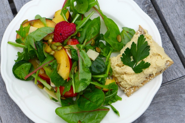Salad, crisp bread and hummus